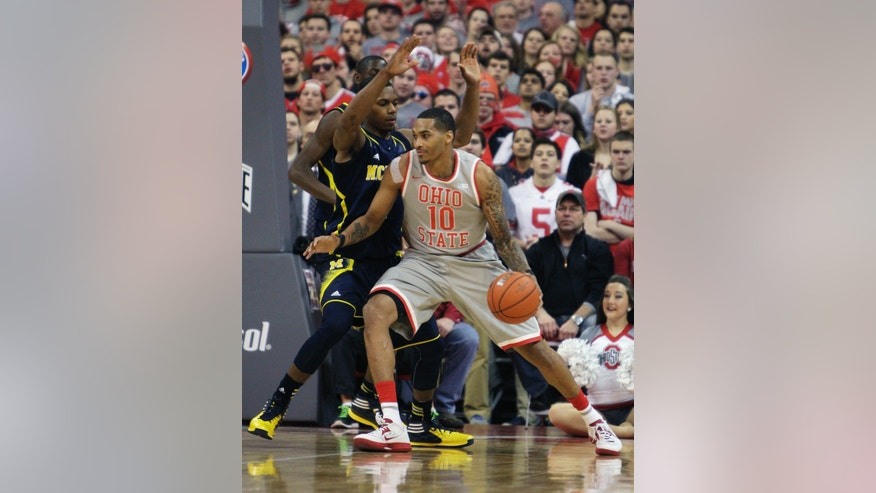 Ohio State's LaQuinton Ross, right, tries to get around Michigan's Glenn Robinson during the first half of an NCAA college basketball game, Tuesday, Feb. 11, 2014, in Columbus, Ohio. (AP Photo/Jay LaPrete)