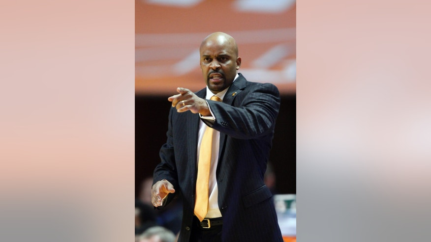Tennessee head coach Cuonzo Martin yells to his player's in the second half of an NCAA college basketball game against Florida on Tuesday, Feb. 11, 2014, in Knoxville, Tenn. Florida won 67-56. (AP Photo/Wade Payne)