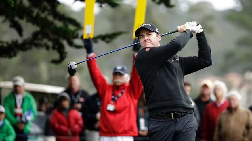 Jimmy Walker hits off the 14th tee Sunday, Feb. 9, 2014, during the final round of the AT&T Pebble Beach Pro-Am golf tournament in Pebble Beach, Calif.  (AP Photo/Ben Margot)
