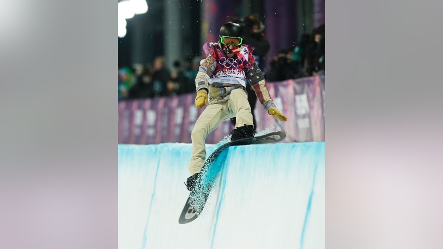 Feb. 11, 2014: Shaun White of the United States hits the edge of the half pipe during the men's snowboard halfpipe final at the Rosa Khutor Extreme Park, at the 2014 Winter Olympics, in Krasnaya Polyana, Russia.
