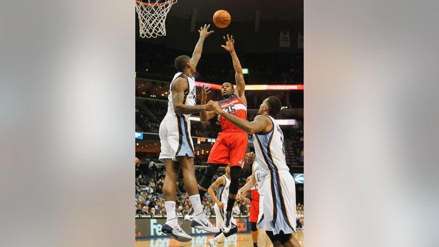 Washington Wizards forward Trevor Booker (35) shoots against Memphis Grizzlies forwards Ed Davis, left, and James Johnson (3) in the first half of an NBA basketball game, Tuesday, Feb. 11, 2014, in Memphis, Tenn. (AP Photo/Lance Murphey)