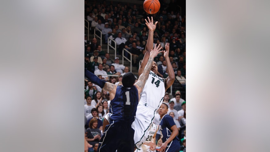 Michigan State's Gary Harris (14) shoots against Penn State's John Johnson (1) during the second half of an NCAA college basketball game, Thursday, Feb. 6, 2014, in East Lansing, Mich. Michigan State won 82-67. (AP Photo/Al Goldis)