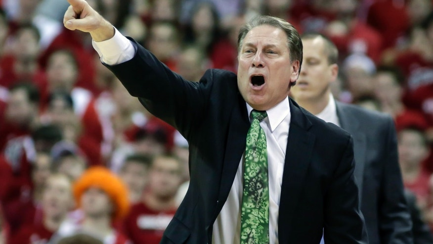 Michigan State coach Tom Izzo yells to his team during during the second of an NCAA college basketball game against Wisconsin, Sunday, Feb. 9, 2014, in Madison, Wis. Wisconsin upset Michigan State, 60-58. (AP Photo/Andy Manis)
