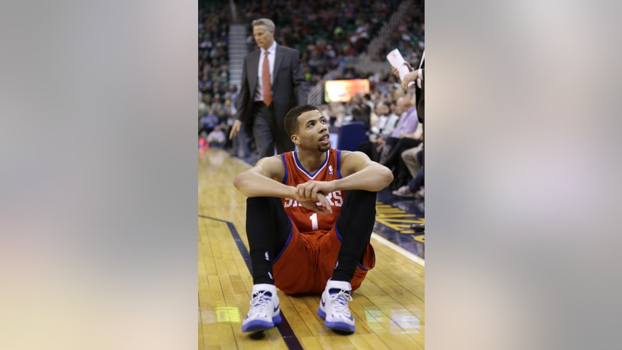 Philadelphia 76ers' Michael Carter-Williams (1) sits on the court after missing a shot in the second quarter of an NBA basketball game against the Utah Jazz, Wednesday, Feb. 12, 2014, in Salt Lake City. (AP Photo/Rick Bowmer)
