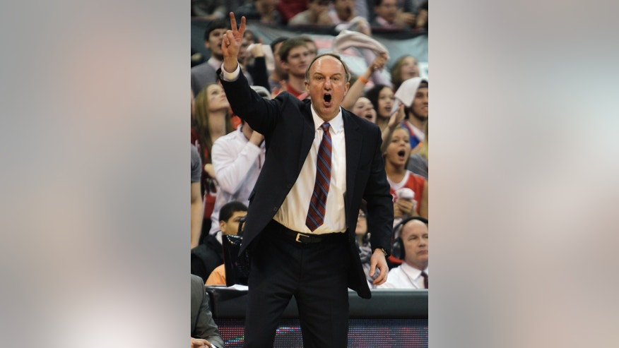 Ohio State head coach Thad Matta shouts to his team during the first half of an NCAA college basketball game against Michigan, Tuesday, Feb. 11, 2014, in Columbus, Ohio. Michigan won 70-60. (AP Photo/Jay LaPrete)