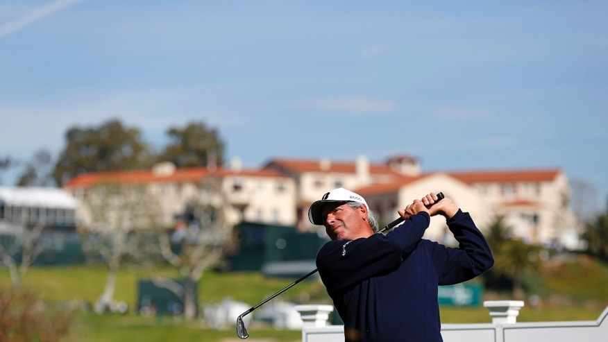 Fred Couples watches his shot from the 14th tee in the pro-am of the Northern Trust Open golf tournament at Riviera Country Club in the Pacific Palisades area of Los Angeles on Wednesday, Feb. 12, 2014. (AP Photo/Reed Saxon)