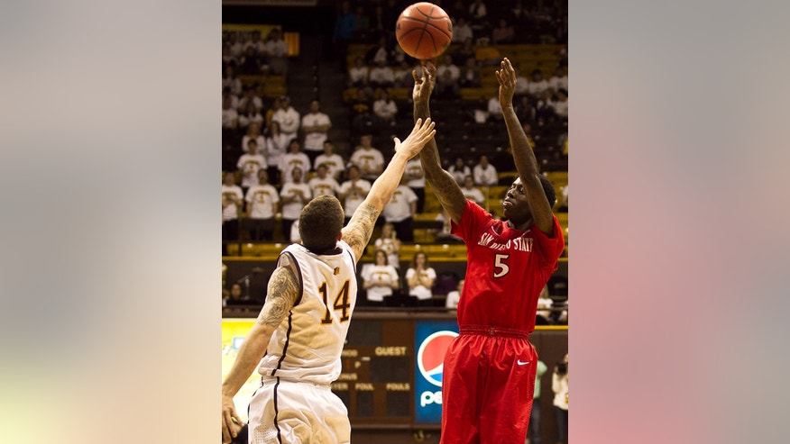 San Diego State forward Dwayne Polee II (5) pulls up for a jump shot over University of Wyoming Cowboy Josh Adams Tuesday, Feb. 11, 2014 at the Arena-Auditorium in Laramie, Wyo. (AP Photo/Jeremy Martin)