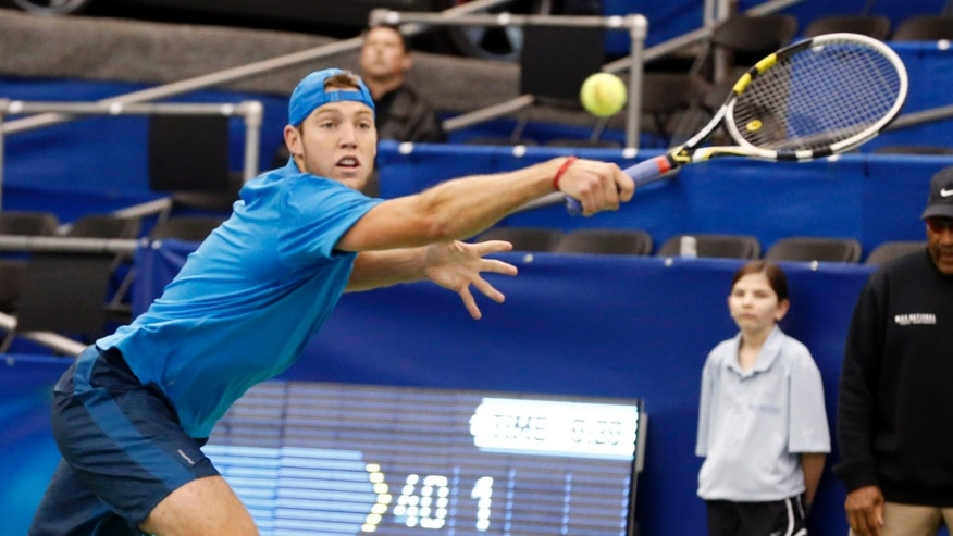 Jack Sock reaches to hit a return to Jiri Vesely, of Czech Republic, in the second round match at the U.S. National Indoor Tennis Championships on Wednesday, Feb. 12, 2014, in Memphis, Tenn. (AP Photo/Rogelio V. Solis)