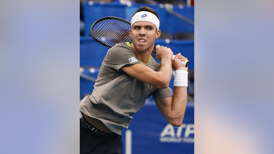 Jiri Vesely, of the Czech Republic, watches his return to Jack Sock, of the United States, at the U.S. National Indoor Tennis Championships on Wednesday, Feb. 12, 2014, in Memphis, Tenn. (AP Photo/Rogelio V. Solis)