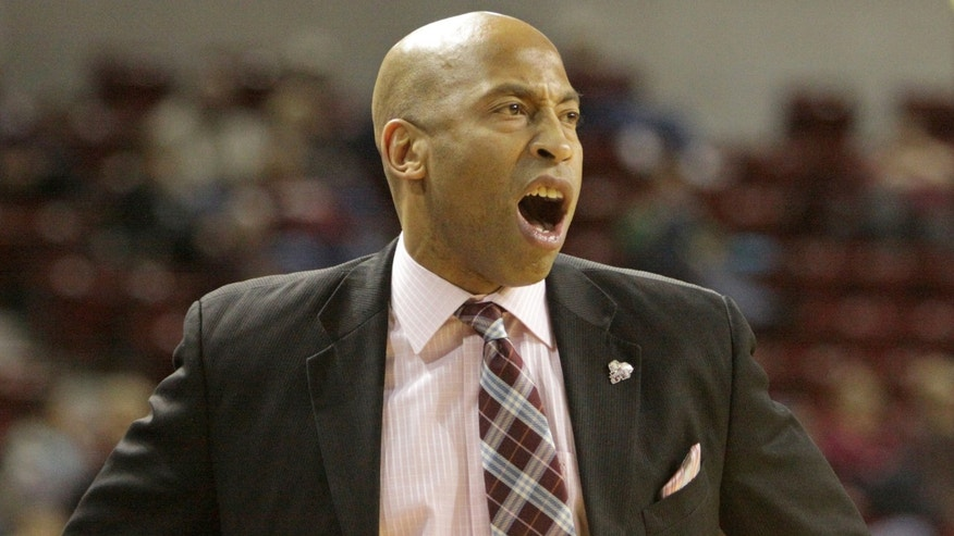 Mississippi State coach Rick Ray shouts instructions to his team during the first half of an NCAA college basketball game against Georgia in Starkville, Miss., Wednesday, Feb. 12, 2014. (AP Photo/Jim Lytle)
