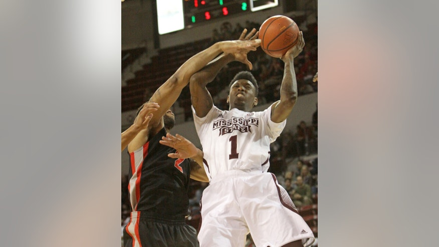 Mississippi State's Fred Thomas (1) shoots as Georgia defender Marcus Thornton (2) attempts to block the ball during the first half of an NCAA college basketball game in Starkville, Miss., Wednesday, Feb. 12, 2014. (AP Photo/Jim Lytle)