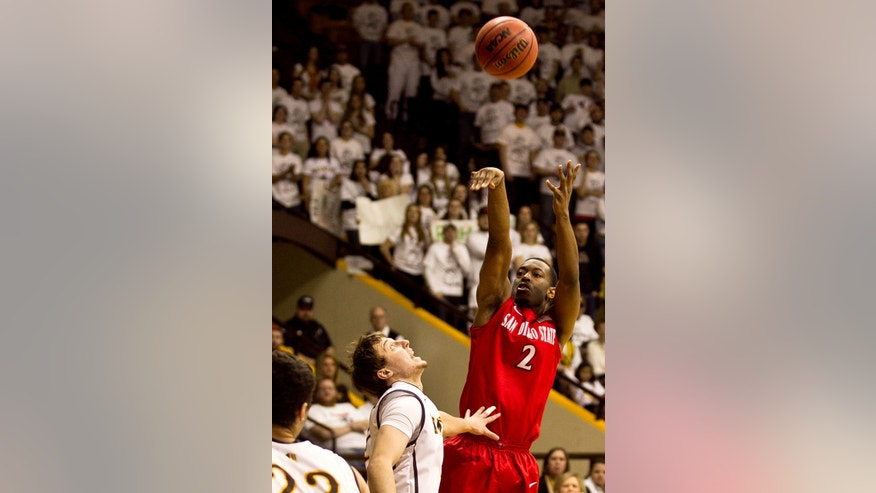 San Diego State guard Xavier Thomas (2) pulls up for a jump shot during the second half of a mens NCAA basketball game Tuesday, Feb. 11, 2014, against Wyoming at the Arena-Auditorium in Laramie, Wyo.(AP Photo/Jeremy Martin)