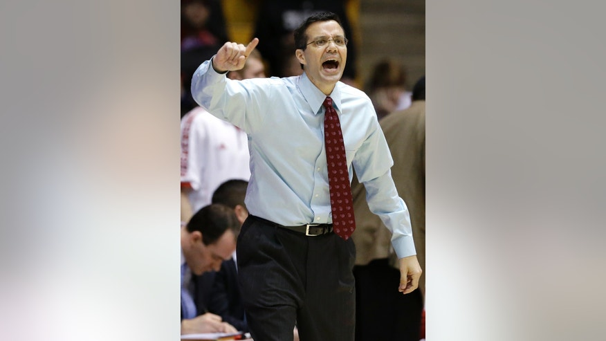 Nebraska head coach Tim Miles yells to his team during the first half of an NCAA college basketball game against Northwestern in Evanston, Ill., on Saturday, Feb.8, 2014. Nebraska won 53-49. (AP Photo/Nam Y. Huh)