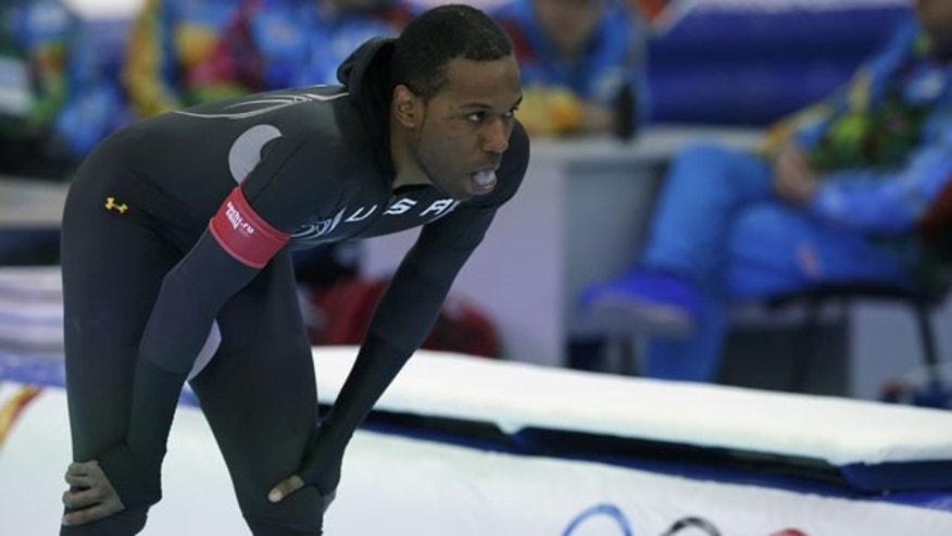 February 12, 2014: Shani Davis of the U.S. gestures in dejection after competing in the men's 1,000-meter speedskating race at the Adler Arena Skating Center during the 2014 Winter Olympics in Sochi, Russia. (AP Photo/Matt Dunham)
