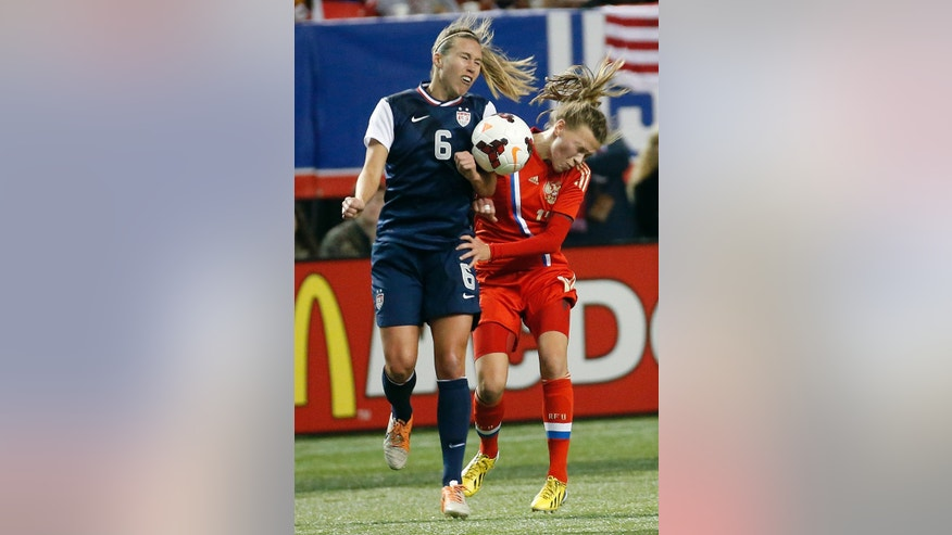 United States' Whitney Engen (6) andRussia's Ekaterina Terekhova try to head the ball during the first half of an exhibition soccer match Thursday, Feb. 13, 2014, in Atlanta. (AP Photo/John Bazemore)