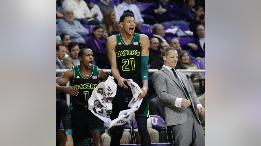 Baylor's Kenny Chery (1), Isaiah Austin (21) and assistant coach Paul Mills react from the bench as they watch a 3-point shot during the second half of an NCAA college basketball game against TCU Wednesday, Feb. 12, 2014, in Fort Worth, Texas. Baylor had a season-high 16 3-pointers in a 91-58 victory over TCU. (AP Photo/LM Otero)