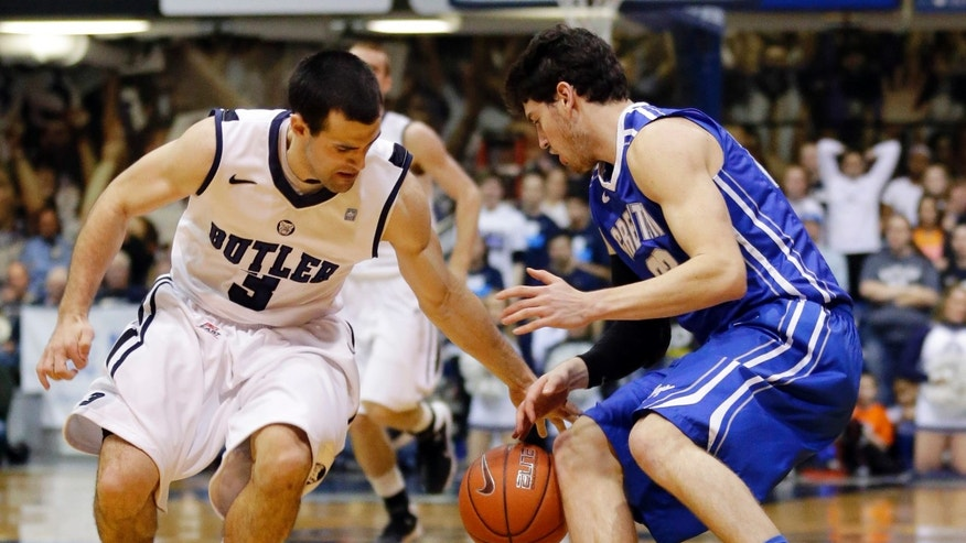 Butler guard Alex Barlow, left, steals the ball from Creighton guard Avery Dingman in the first half of an NCAA college basketball game in Indianapolis, Thursday, Feb. 13, 2014. (AP Photo/Michael Conroy)