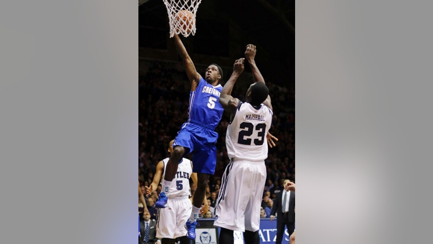 Creighton guard Devin Brooks (5) gets a bucket over Butler forward Khyle Marshall in the first half of an NCAA college basketball game in Indianapolis, Thursday, Feb. 13, 2014. (AP Photo/Michael Conroy)