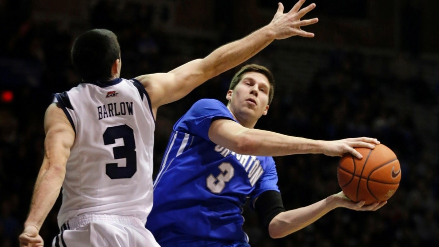 Creighton forward Doug McDermott, right, goes around Butler guard Alex Barlow for a shot in the first half of an NCAA college basketball game in Indianapolis, Thursday, Feb. 13, 2014. (AP Photo/Michael Conroy)