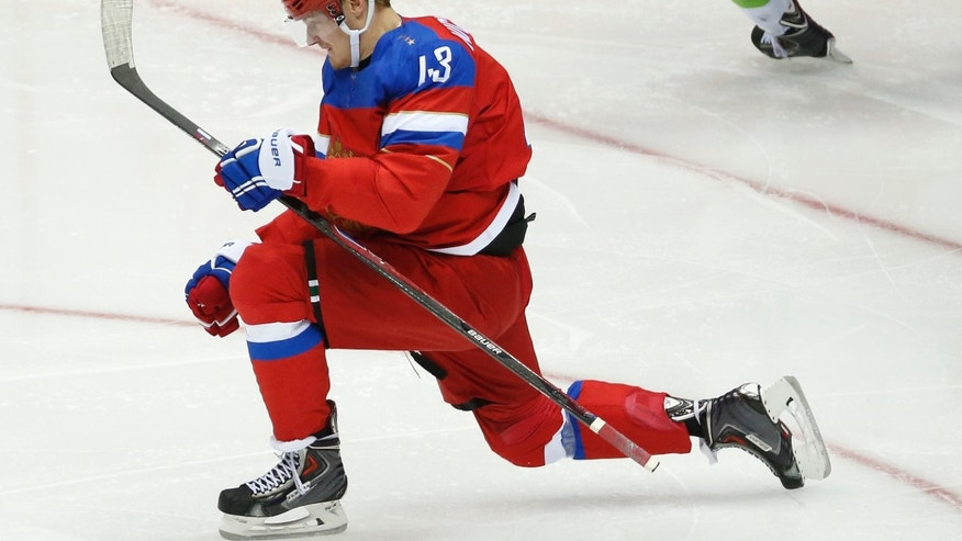 Russia forward Valeri Nichushkin reacts after scoring against Slovenia in the third period of a men's ice hockey game at the 2014 Winter Olympics, Thursday, Feb. 13, 2014, in Sochi, Russia. (AP Photo/Mark Humphrey)