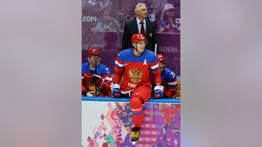 Russia forward Alexander Ovechkin watches play against Slovenia from the bench in the second period of a men's ice hockey game at the 2014 Winter Olympics, Thursday, Feb. 13, 2014, in Sochi, Russia. (AP Photo/Mark Humphrey)