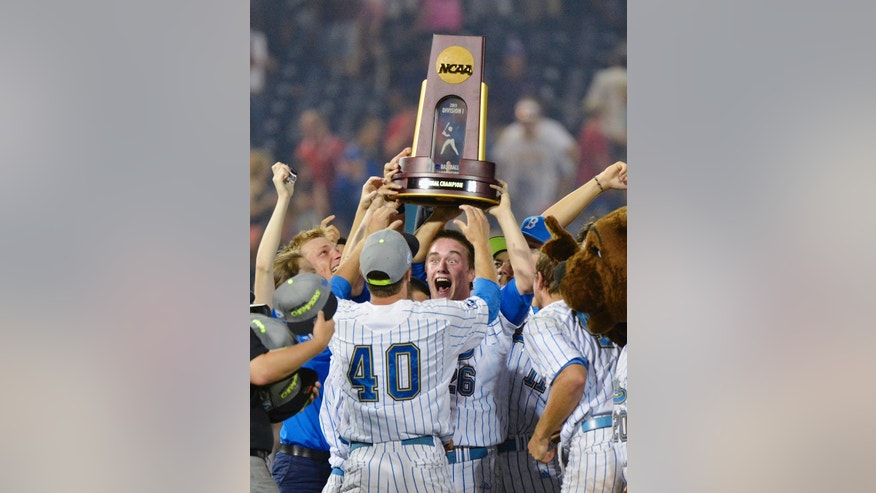 ADVANCE FOR WEEKEND EDITIONS, FEB. 15-16 - FILE - In this June 25, 2013, file photo, UCLA closing pitcher David Berg (26) stands in front of teammate Ryan Deeter (40) as Berg and other players hoist the championship trophy after UCLA defeated Mississippi State 8-0 in the second game of the NCAA College World Series baseball finals, in Omaha, Neb. UCLA lost two of its three weekend starters and the Pac-12 defensive player of the year, and less than a month before their opener the Bruins found out they would lose their best returning outfielder for the season. None of that has kept the Bruins from believing they can make it to the College World Series for a fourth time in five years and maybe even win another national championship. (AP Photo/Ted Kirk)