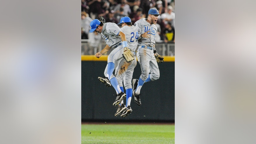 ADVANCE FOR WEEKEND EDITIONS, FEB. 15-16 - FILE - In this June 24, 2013, file photo, UCLA outfielders from left: Christoph Bono, Brian Carroll and Eric Filia celebrate their 3-1 win over Mississippi State in Game 1 of the NCAA College World Series baseball best-of-three finals, in Omaha, Neb. UCLA lost two of its three weekend starters and the Pac-12 defensive player of the year, and less than a month before their opener the Bruins found out they would lose their best returning outfielder for the season. None of that has kept the Bruins from believing they can make it to the College World Series for a fourth time in five years and maybe even win another national championship. (AP Photo/Eric Francis)
