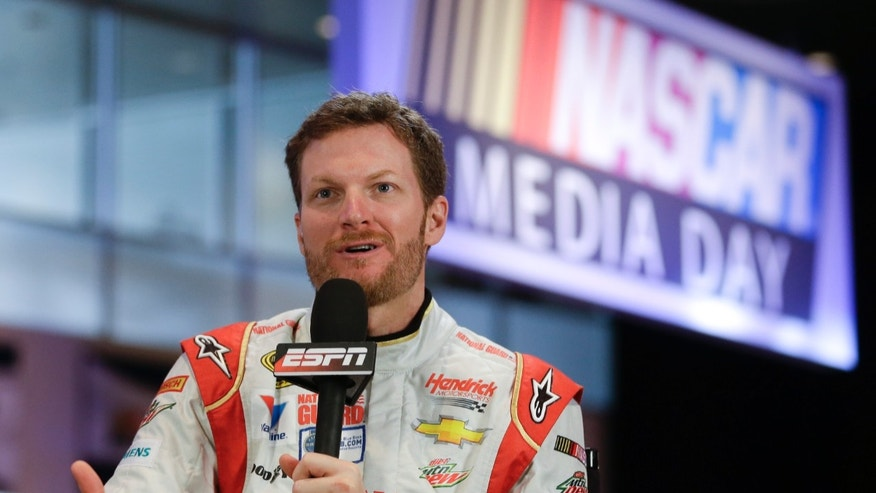 Driver Dale Earnhardt Jr. answers a question during a live TV interview at NASCAR auto racing media day at Daytona International Speedway in Daytona Beach, Fla., Thursday, Feb. 13, 2014. (AP Photo/John Raoux)