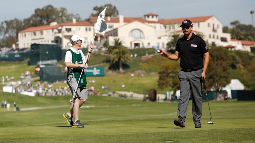 Padraig Harrington, of Ireland, makes par on the 10th green in the first round of the Northern Trust Open golf tournament at Riviera Country Club in the Pacific Palisades area of Los Angeles Thursday, Feb. 13, 2014.  (AP Photo/Reed Saxon)