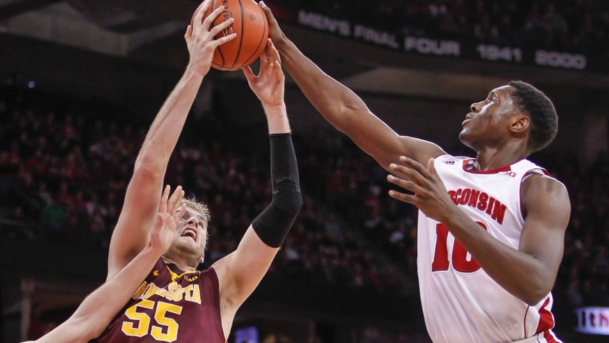 Minnesota's Elliott Eliason, left, and Wisconsin's Nigel Hayes go after a rebound during the first half of an NCAA college basketball game Thursday, Feb. 13, 2014, in Madison, Wis. (AP Photo/Andy Manis)