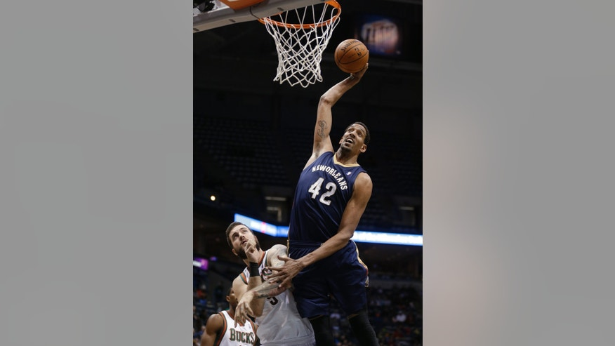 New Orleans Pelicans' Alexis Ajinca (42) dunks over Miwaukee Bucks' Miroslav Raduljica during the second half of an NBA basketball game Wednesday, Feb. 12, 2014, in Milwaukee. (AP Photo/Jeffrey Phelps)