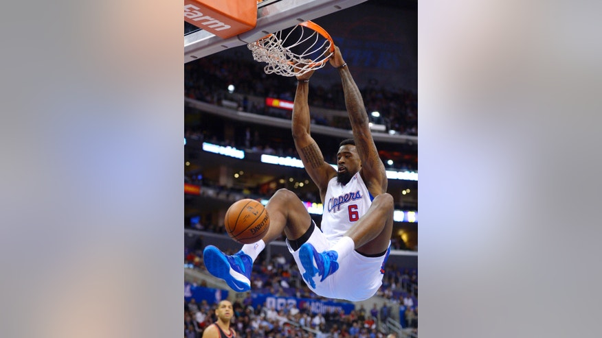 Los Angeles Clippers center DeAndre Jordan dunks during the first half of an NBA basketball game against the Portland Trail Blazers, Wednesday, Feb. 12, 2014, in Los Angeles. (AP Photo/Mark J. Terrill)