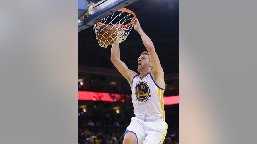 Golden State Warriors' David Lee (10) dunks against the Philadelphia 76ers during the second half of an NBA basketball game on Monday, Feb. 10, 2014, in Oakland, Calif.  Golden State won 123-80. (AP Photo/Marcio Jose Sanchez)