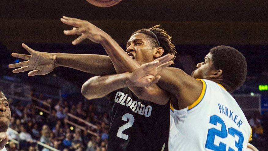 Colorado forward Xavier Johnson, left, and UCLA forward Tony Parker, battle for a loose ball in the first half of an NCAA college basketball game Thursday, Feb. 13, 2014, in Los Angeles. (AP Photo/Ringo H.W. Chiu)