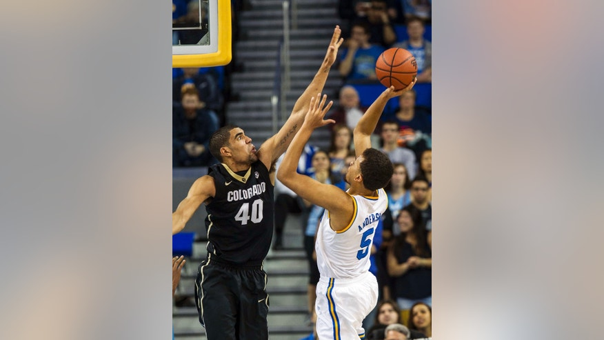 UCLA guard Kyle Anderson, right, shoots against Colorado forward Josh Scott in the first half of an NCAA college basketball game Thursday, Feb. 13, 2014, in Los Angeles. (AP Photo/Ringo H.W. Chiu)