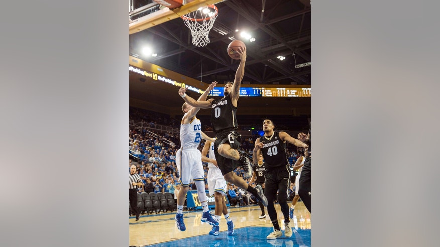 Colorado forward Josh Scott, right, stands near as his teammate Askia Booker, center, goes for a layup against UCLA guard Jordan Adams in the first half of an NCAA college basketball game Thursday, Feb. 13, 2014, in Los Angeles. (AP Photo/Ringo H.W. Chiu)