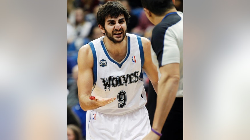 Minnesota Timberwolves' Ricky Rubio, of Spain, shows his bloody thumb to an official as he pleads for a foul call after Denver Nuggets's Randy Foye shouldered him in the mouth in the first quarter of an NBA basketball game Wednesday, Feb. 12, 2014, in Minneapolis. (AP Photo/Jim Mone)