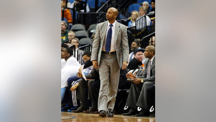 Denver Nuggets head coach Brian Shaw walks on the sidelines in the second half of an NBA basketball game Wednesday, Feb. 12, 2014, in Minneapolis where the Minnesota Timberwolves beat the Nuggets 117-90. (AP Photo/Jim Mone)