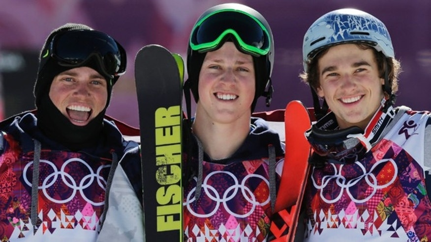 Feb. 13, 2014: Men's ski slopestyle gold medal winner Joss Christensen of the United States, center, celebrates on the podium with his teammates Gus Kenworthy, left, silver, and Nicholas Goepper, bronze, right, during a flower ceremony at the Rosa Khutor Extreme Park, at the 2014 Winter Olympics in Krasnaya Polyana, Russia.