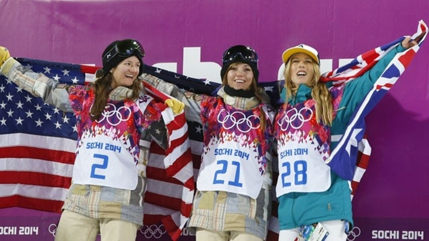 February 12, 2014: From left, bronze medalist Kelly Clark; gold medalist  Kaitlyn Farrington; both of the United States and silver medalist  Torah Bright of Australia pose following the women's snowboard halfpipe at the Rosa Khutor Extreme Park, at the 2014 Winter Olympics in Krasnaya Polyana, Russia. (AP Photo/Sergei Grits)