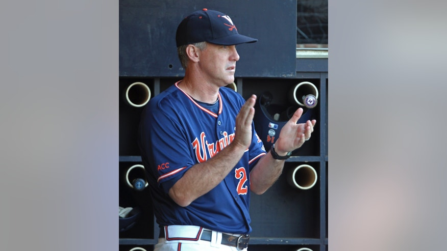 FILE - In this June 1, 2013, file photo, Virginia coach Brian O'Connor claps in the dugout during the fifth inning of an NCAA college baseball tournament regional game against Elon in Charlottesville, Va. O'Connor looked at his schedule, looked at how much talent was on his roster and knew he needed to make a change. A few phone calls later, O'Connor's Virginia baseball team no longer planned to open the season with a non-descript three-game series at home, but in a tournament in Wilmington, N.C., with three other quality programs. (AP Photo/Andrew Shurtleff, File)
