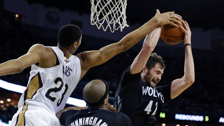 Minnesota Timberwolves power forward Kevin Love (42) pulls in a rebound against New Orleans Pelicans power forward Anthony Davis (23) in the second half of an NBA basketball game in New Orleans, Friday, Feb. 7, 2014. The Pelicans won 98-91. (AP Photo/Gerald Herbert)