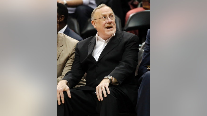 Minnesota Timberwolves head coach Rick Adelman sits on the bench late in the second half of an NBA basketball game Wednesday, Feb. 12, 2014, in Minneapolis where the Timberwolves beat the Denver Nuggets 117-90. (AP Photo/Jim Mone)