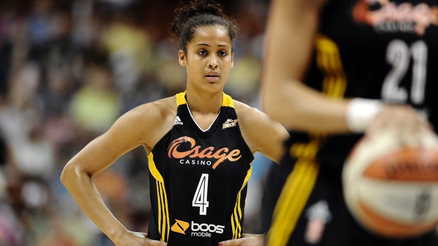 FILE - In this July 2, 2013, file photo, Tulsa Shock's Skylar Diggins watches play during the first half of a WNBA basketball game in Uncasville, Conn.  From the Grammys to the Super Bowl, Diggins has been making the rounds at star-studded events. Now she'll be headed to New Orleans to participate in the NBA All-Star weekend. Yet it hasn't been all play for Diggins, who was coming off a disappointing rookie season with the Shock. She's been busy expanding her brand.  (AP Photo/Jessica Hill, File)