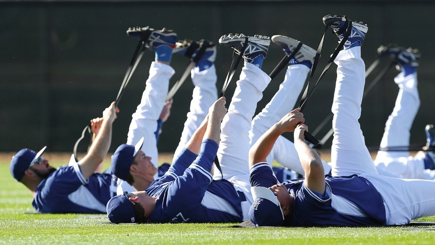 Los Angeles Dodgers pitchers stretch during spring training baseball practice Tuesday, Feb. 11, 2014, in Glendale, Ariz. (AP Photo/Paul Sancya)