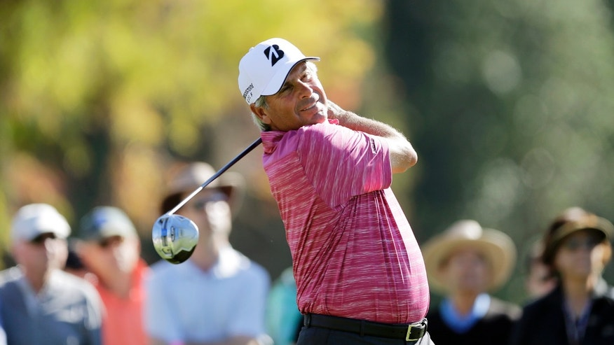 Fred Couples hits from the second tee during the second round of the Northern Trust Open golf tournament at Riviera Country Club in the Pacific Palisades area of Los Angeles Friday, Feb. 14, 2014.  (AP Photo/Reed Saxon)