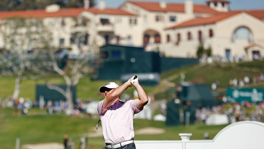 Robert Garrigus tees off on the 14th hole during the second round of the Northern Trust Open golf tournament at Riviera Country Club in the Pacific Palisades area of Los Angeles Friday, Feb. 14, 2014.  (AP Photo/Reed Saxon)