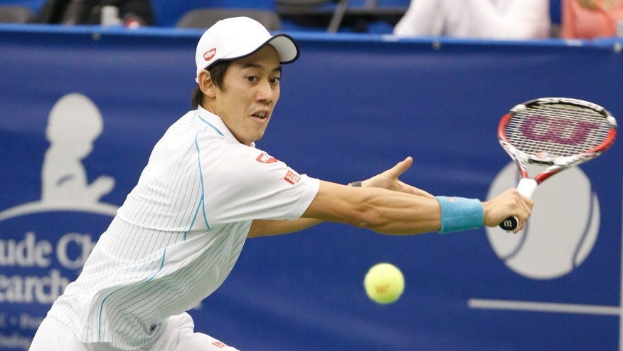 Kei Nishikori, of Japan, hits a return to Alex Bogomolov Jr., of Russia, during a quarterfinal match at the U.S. National Indoor Tennis Championships on Friday, Feb. 14, 2014, in Memphis, Tenn. (AP Photo/Rogelio V. Solis)