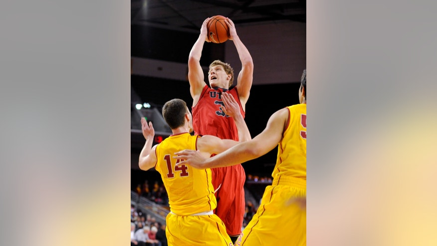 Utah center Dallin Bachynski (31) shoots over Southern California forward Strahinja Gavrilovic (14) during the first half of an NCAA college basketball game, Thursday, Feb. 13, 2014, in Los Angeles. (AP Photo/Gus Ruelas)