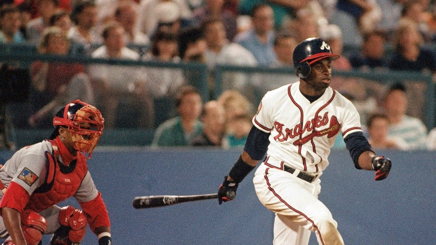 """FILE - In this April 20, 1994, file photo, Atlanta Braves Deion Sanders hits a two-run single during the Braves 8-3 loss to the St. Louis Cardinals during a baseball game in Atlanta.  Florida State's Jameis Winston will become the sixth Heisman winner to play college baseball after winning the award and the first since Bo Jackson in 1986. Sanders said his advice to Winston has been """"letting him know, stay right. Don't take the left, just stay right."""" (AP Photo/John Bazemore, File)"""
